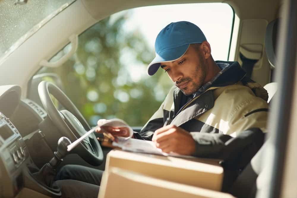 Courier delivery driver in van
