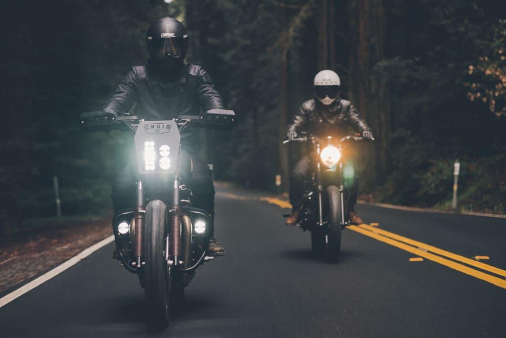 Two motorcycle riders wearing helmets