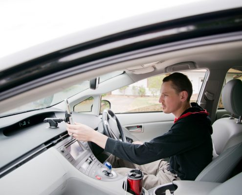 Uber driver checking mobile phone