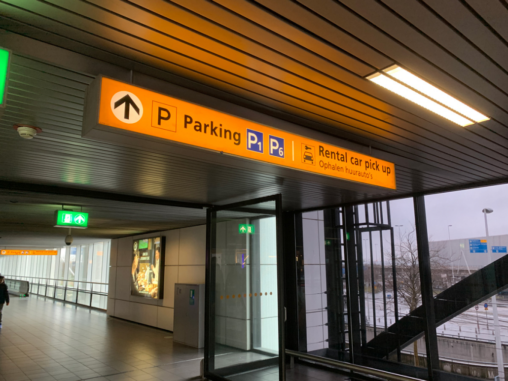 Rental car pick up sign at Amsterdam Schiphol airport