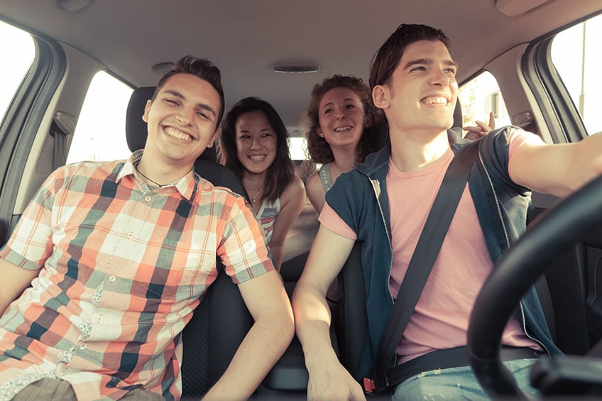 Groups of friends in car sharing the driving.