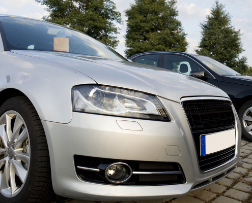 Cars for sale on garage forecourt