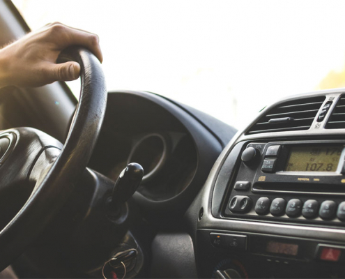 Man driving car - toyota steering wheel and dashboard
