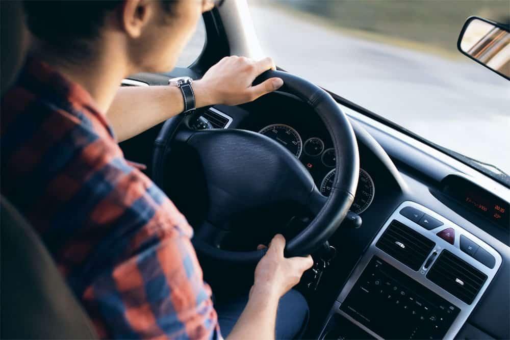 Man driving car - no visible branding of vehicle make