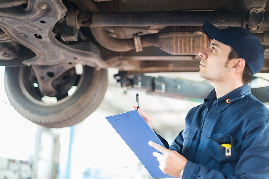 Mechanic inspecting a car for any defects or issues