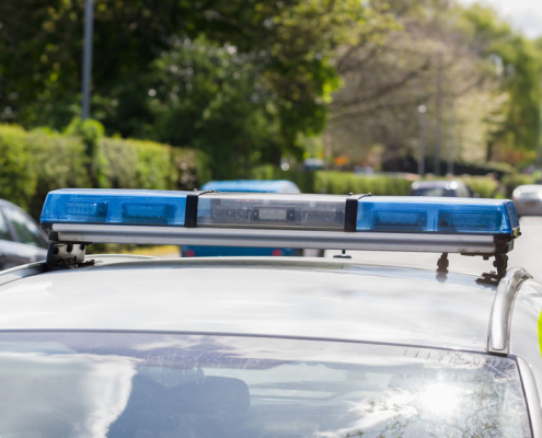 Police car with blue lights on the roof