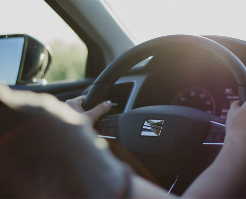 Woman driving Seat car - close up image of hands and steering wheel