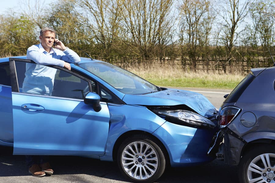 Phone on phone calling car insurance company after accident